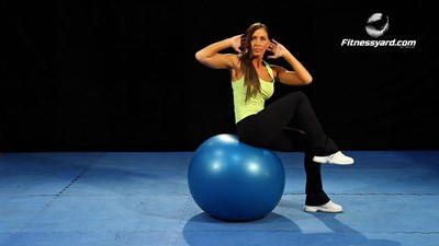 Twisting Exercise ball crunches with knee raise